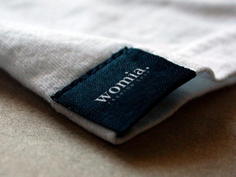 imagen corporativa etiqueta womia